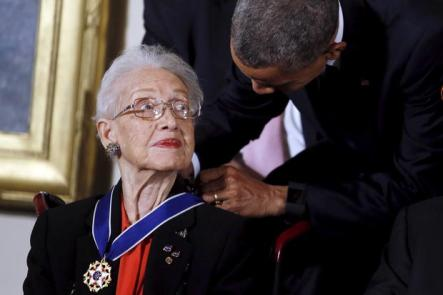U.S. President Barack Obama presents the Presidential Medal of Freedom to NASA mathematician Katherine G. Johnson during an event in the East Room of the White House in Washington